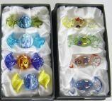 Set mit 4 ovalen Glasbonbons