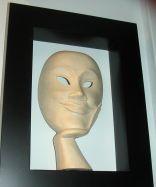 Maske im Rahmen